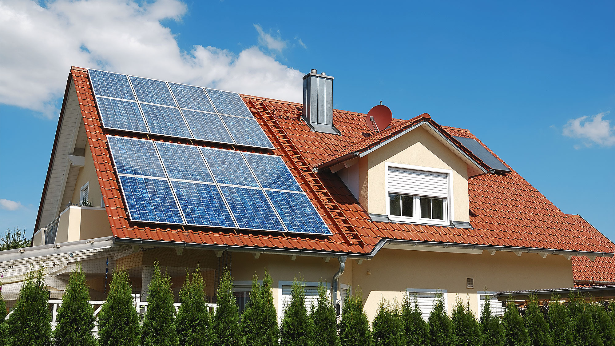Residential house with solar panels on the roof
